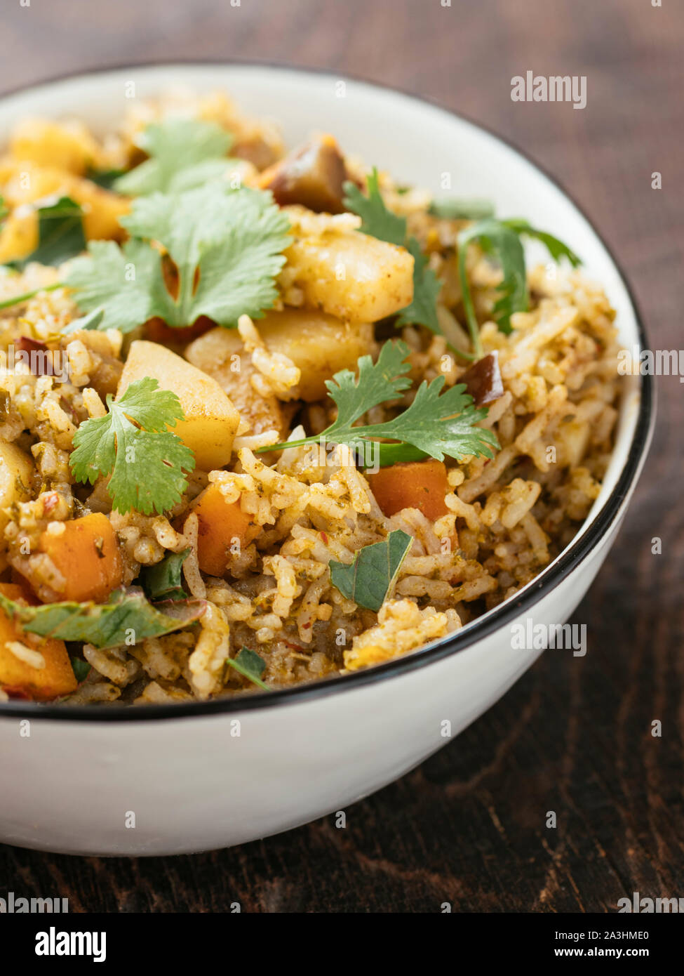 Gongura Biryani with rice, roselle leaves, carrots, potatoes, eggplant and onions Stock Photo