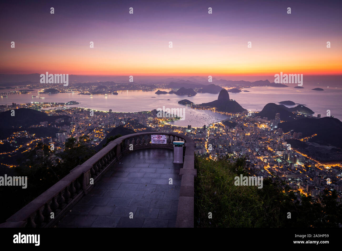 Beautiful sunrise view from an empty Corcovado Mountain to the Sugar Loaf, city and ocean, Rio de Janeiro, Brazil Stock Photo