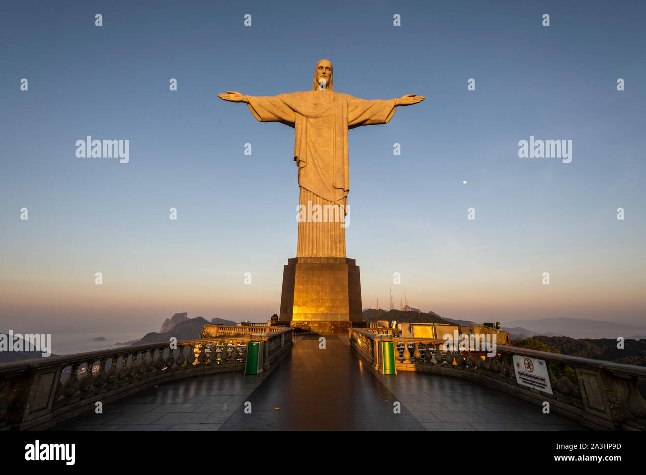 View to Christ the Redeemer Statue during sunrise up on Corcovado Mountain, Rio de Janeiro, Brazil Stock Photo