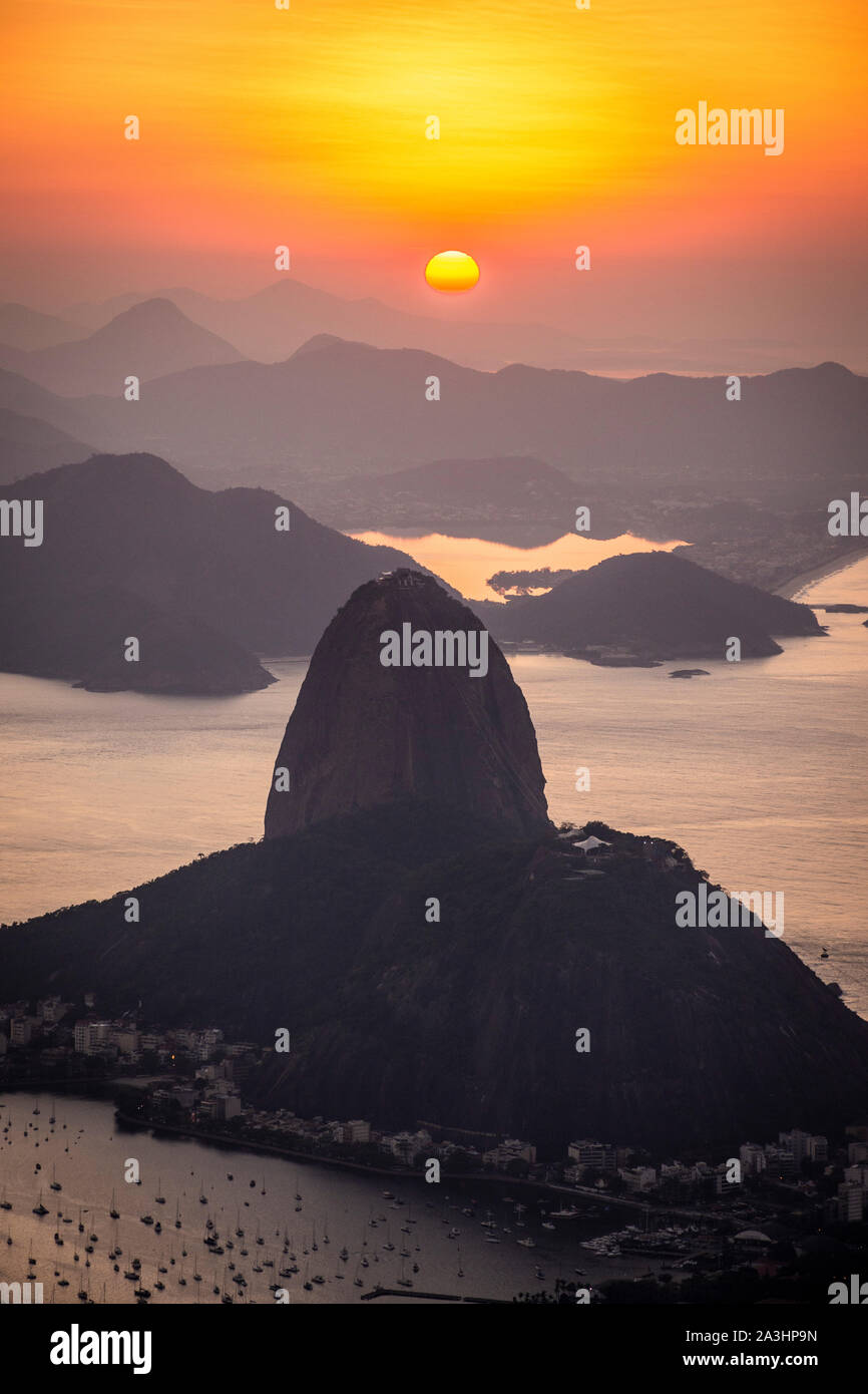 Beautiful sunrise view from Corcovado Mountain to the Sugar Loaf, city and ocean, Rio de Janeiro, Brazil Stock Photo