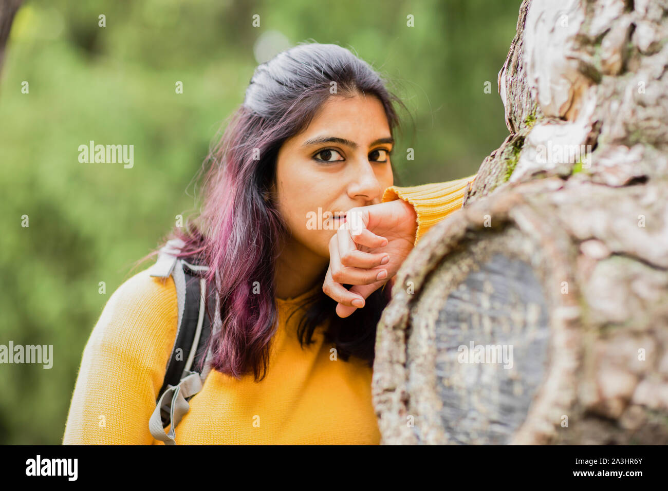 young woman between trees Stock Photo