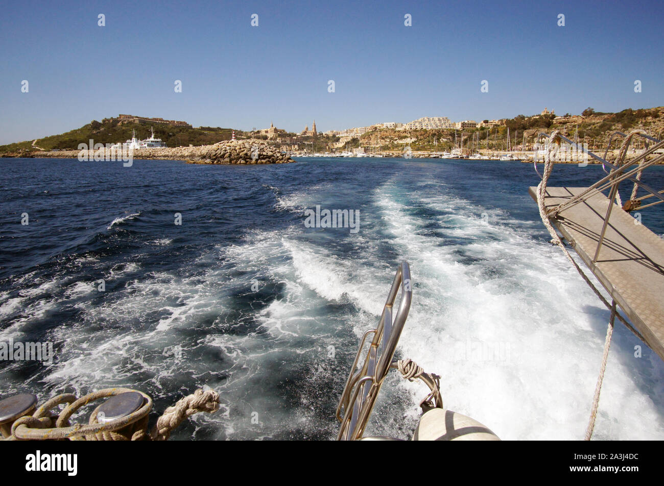 Landscape of Mgarr Harbor in Gozo, Malta visible from yacht deck Stock Photo