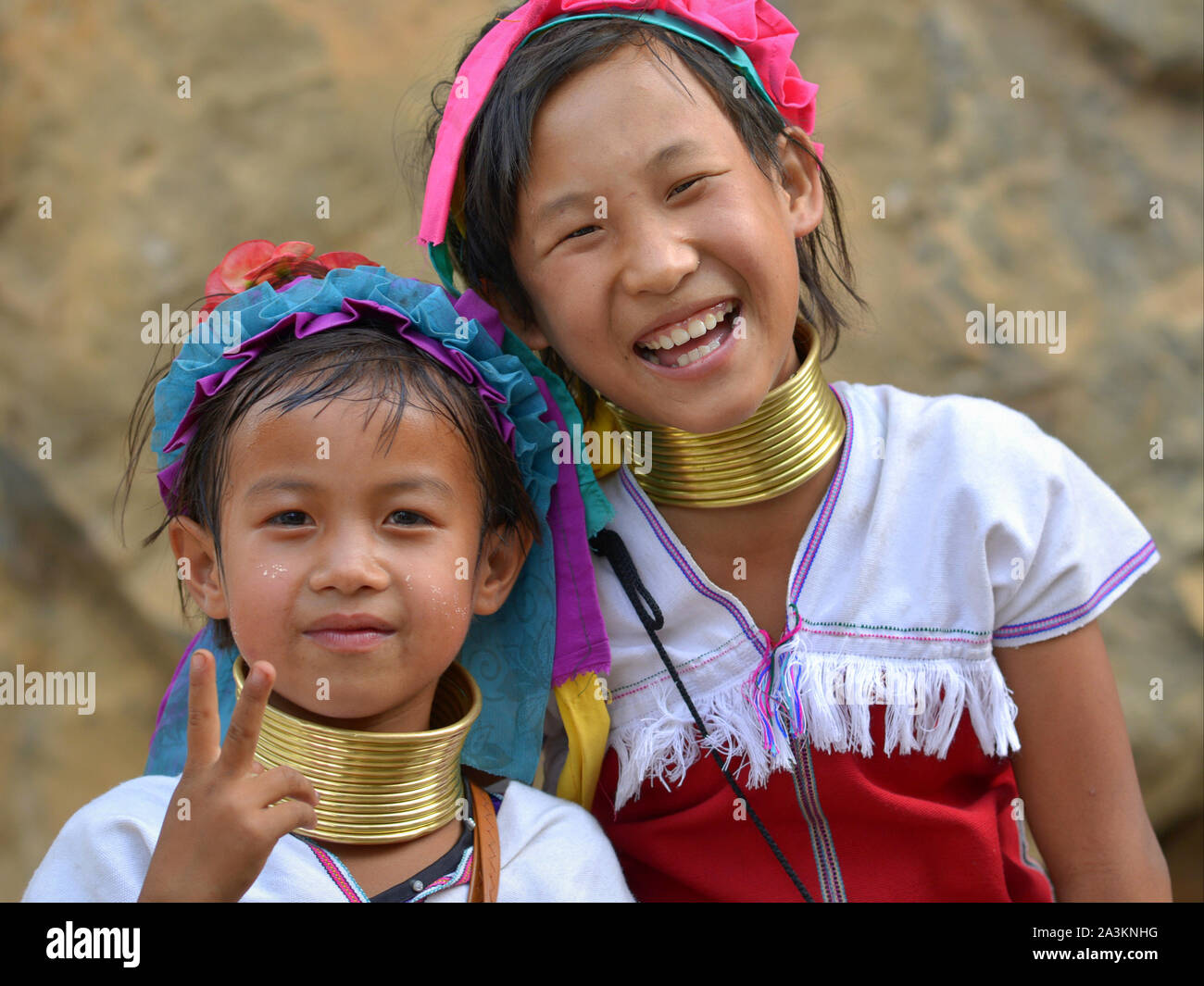 Two Myanmarese Kayan Lahwi girls with tribal brass neck rings/coils pose for the camera. Stock Photo