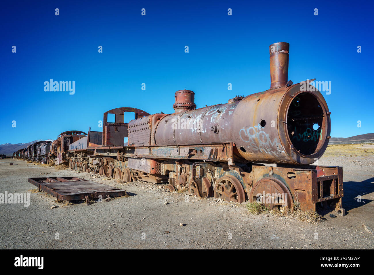 Old rusty locomotive abandoned in the train cemetery of Uyuni, Bolivia Stock Photo
