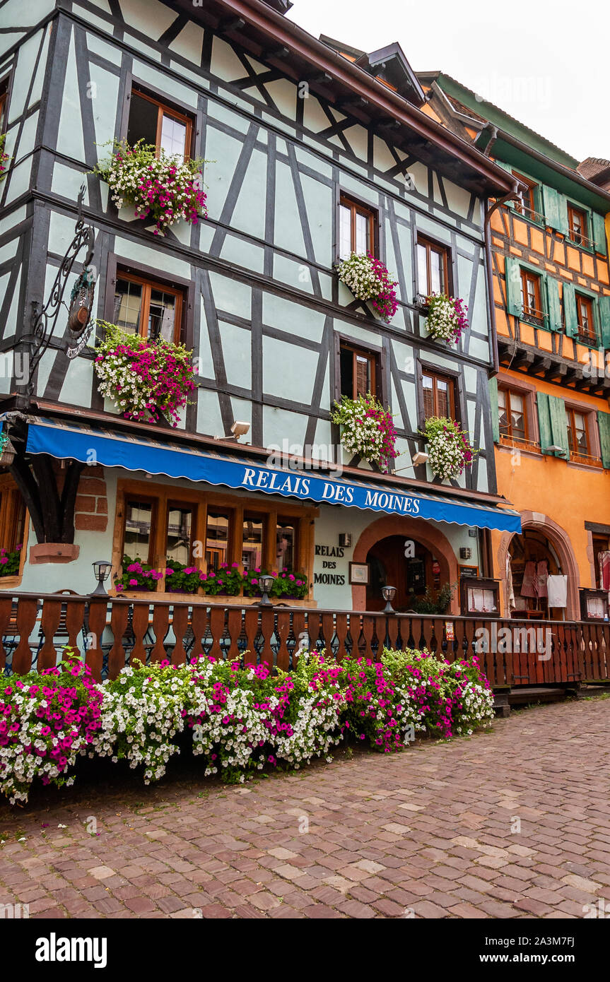 Riquewihr in Alsace, France. Enchanting medieval village, along the wine road that connects Colmar to Strasbourg. View of the old village within the w Stock Photo