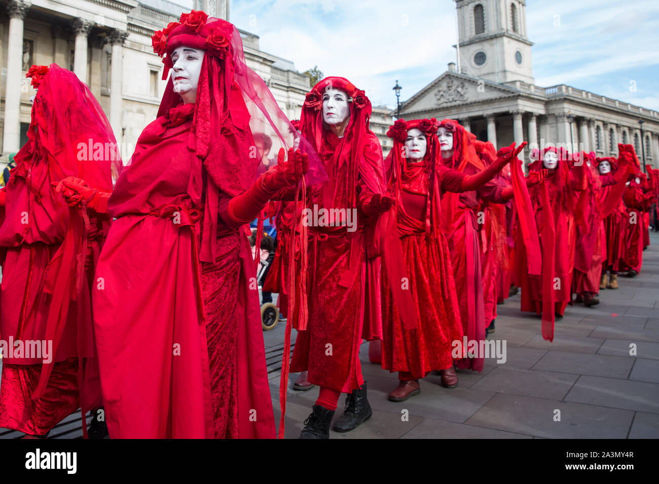 London, UK. 9 October, 2019. Climate activists from the Extinction Rebellion Red Brigade gather in Trafalgar Square on the third day of International Rebellion protests to demand a government declaration of a climate and ecological emergency, a commitment to halting biodiversity loss and net zero carbon emissions by 2025 and for the government to create and be led by the decisions of a Citizens' Assembly on climate and ecological justice. Credit: Mark Kerrison/Alamy Live News Stock Photo