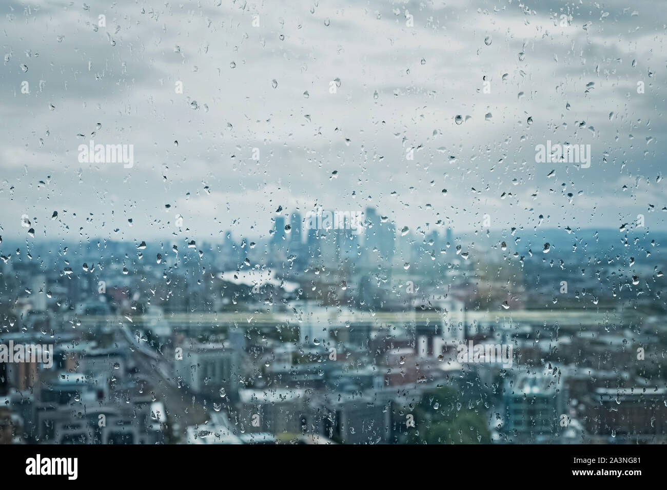 Drops of rain on the glass on the background of London city. Focus on drops. Stock Photo