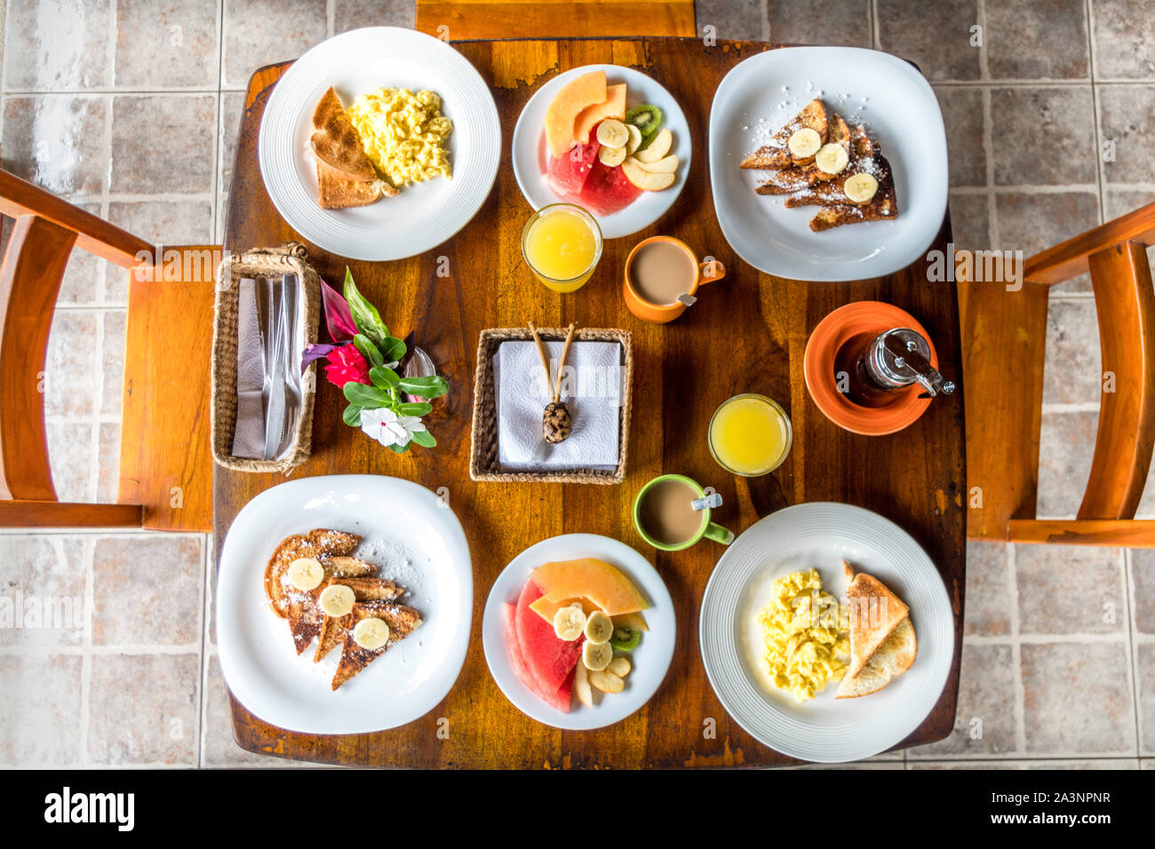 Full American Breakfast with coffee, orange juice, fresh fruits, eggs and french toasts for two Stock Photo