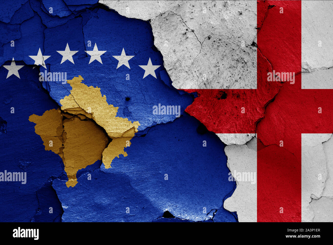 flags of Kosovo and England painted on cracked wall Stock Photo