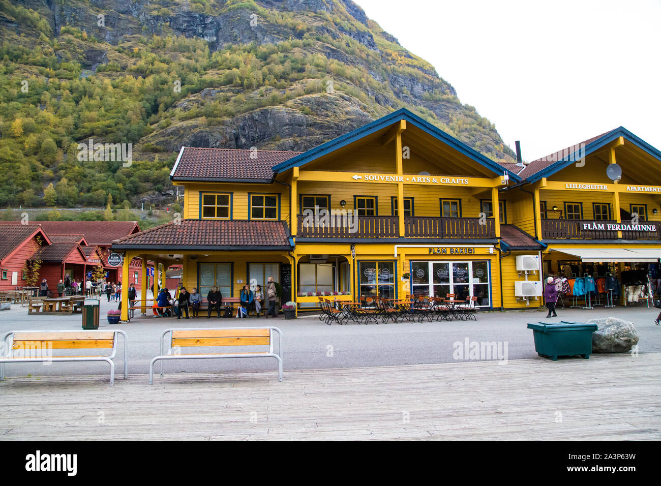 Two Empty Benches Sit In Front Of A Souvenir Shop In Flam Norway Stock Photo Alamy