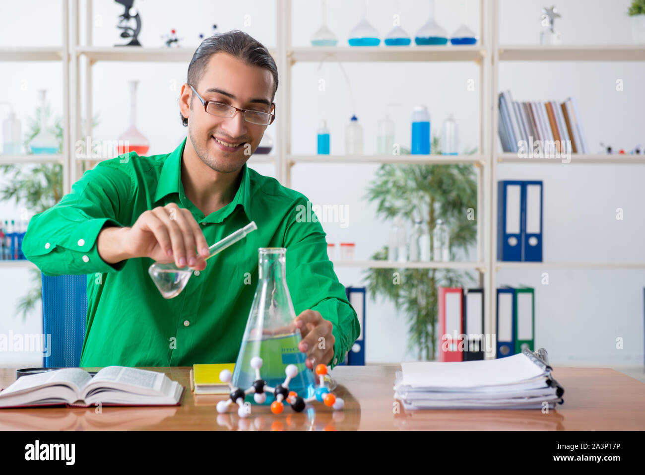 The chemistry student studying for exams Stock Photo