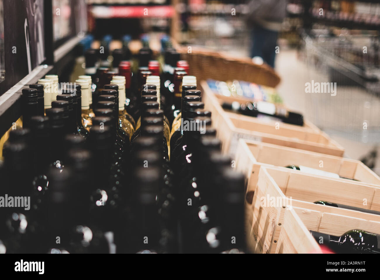 Wine Bottles. Selective focus. Wine storage. Showcase with wine. Presentation of wine in the trade Stock Photo
