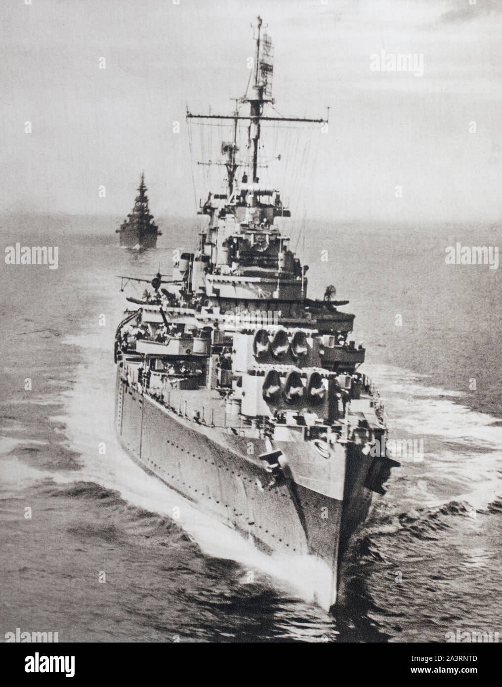 "The most modern units of the American fleet participate in Pacific operations. The cruiser ""Philadelphia"", preceding the cruiser"" Augusta"", on reconna Stock Photo"