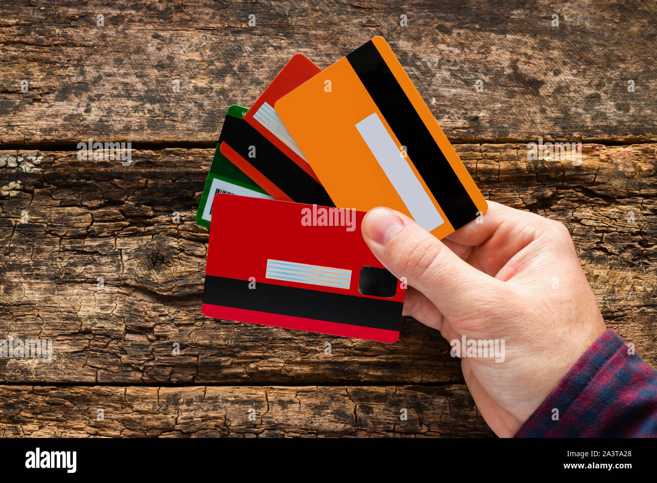 man holding multiple credit cards Stock Photo