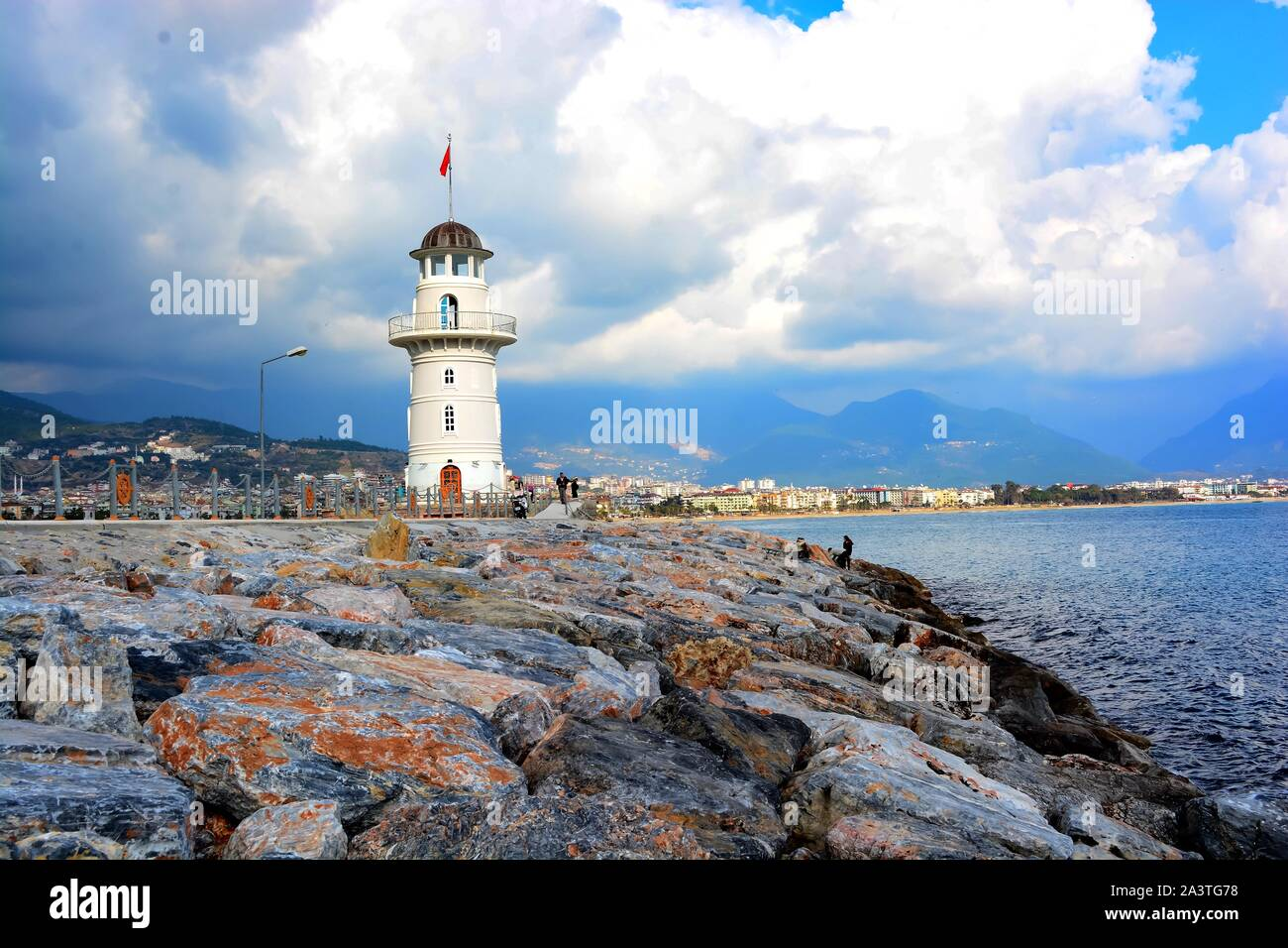 Alanya Harbour in early Spring before the new season starts. Boats are being refurbed & lovers attach locks to the harbour barriers to show their love Stock Photo