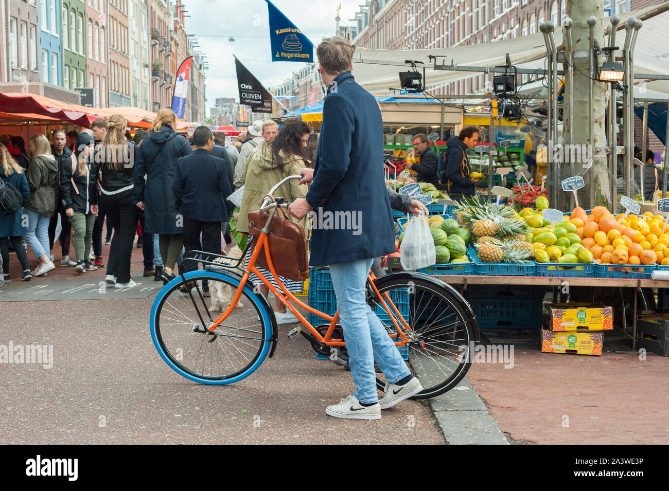 Albert Cuypmarket in Amsterdam and market stall with fruits. Stock Photo