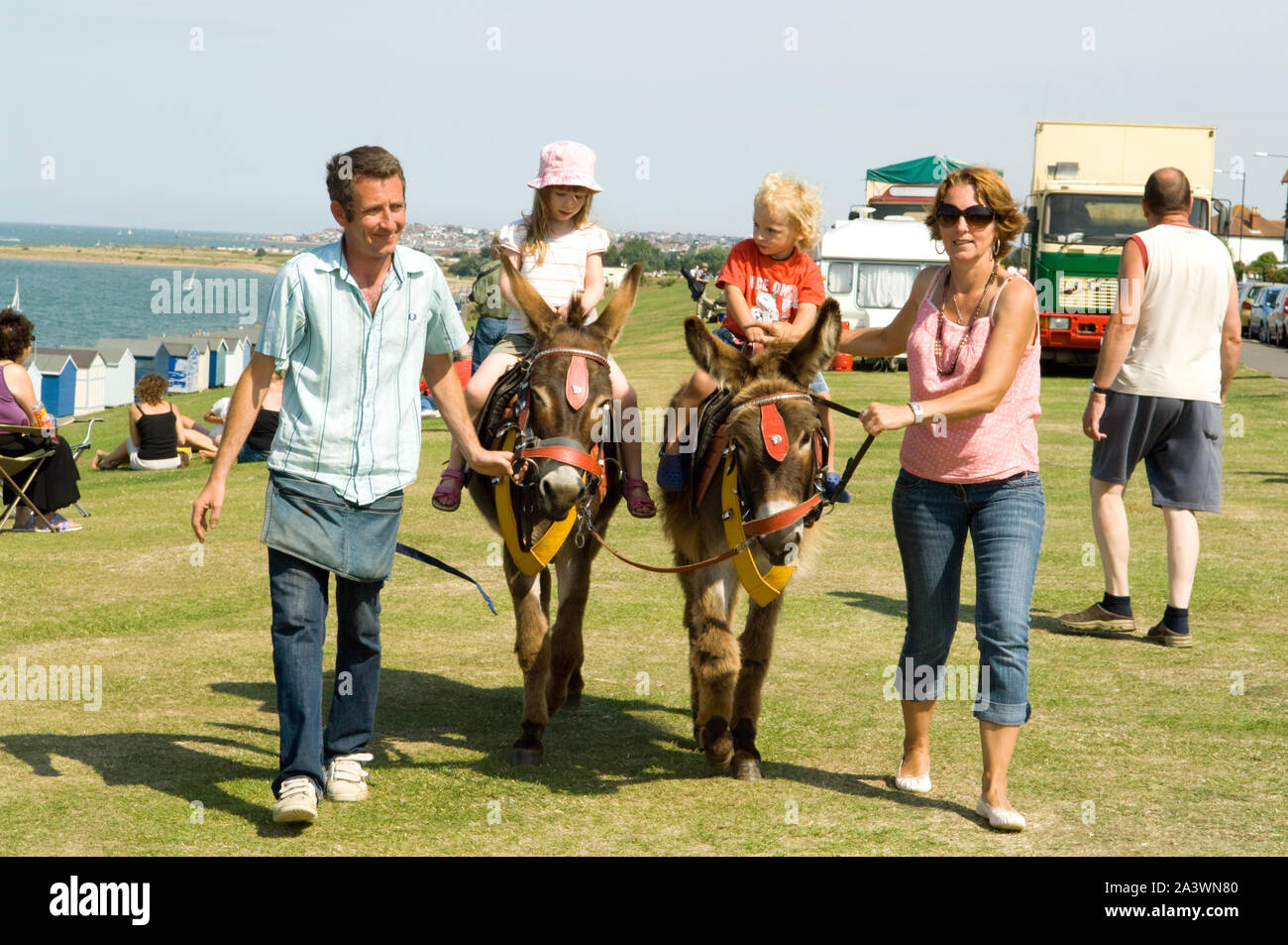 Children on Donkeys at a fair Stock Photo