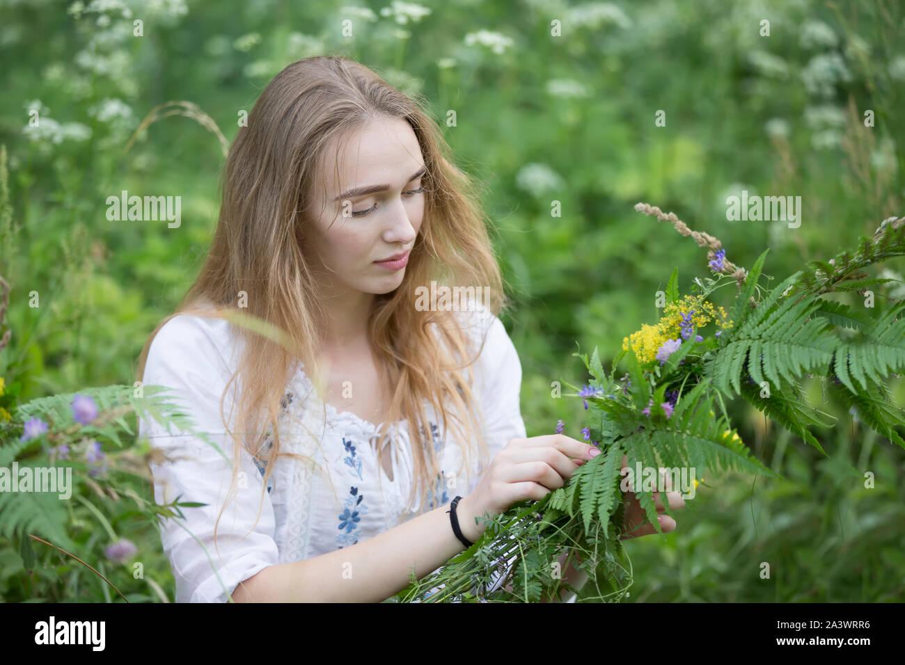 https://c8.alamy.com/comp/2A3WRR6/belarus-the-city-of-gomel-july-07-2018-holiday-kupala-the-girl-weaves-a-wreath-for-the-kupala-night-slavic-summer-holidays-belarusian-or-ukrain-2A3WRR6.jpg