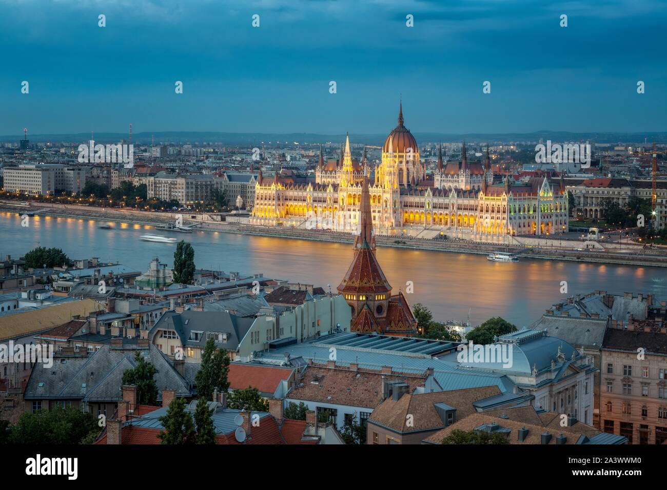 HUNGARIAN PARLIAMENT LIT UP AT TWILIGHT, REFLECTIONS IN THE DANUBE, BUDAPEST, HUNGARY Stock Photo