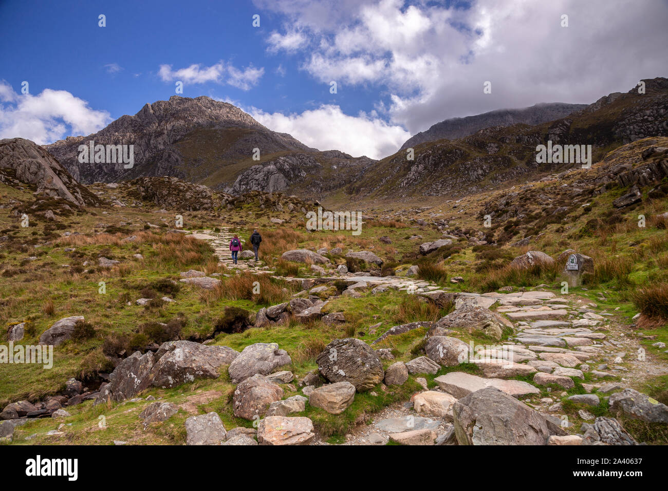Couple hiking towards Tryfan mountain, Snowdonia, North Wales Stock Photo