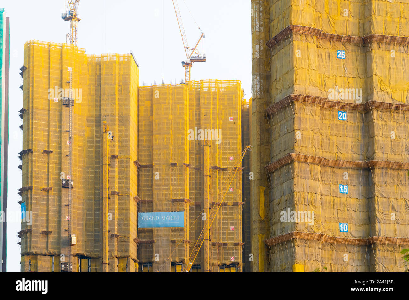 View of new  dense urban high-rise apartment buildings in LOHAS Park new housing estate in New Territories of Hong Kong, China. Stock Photo