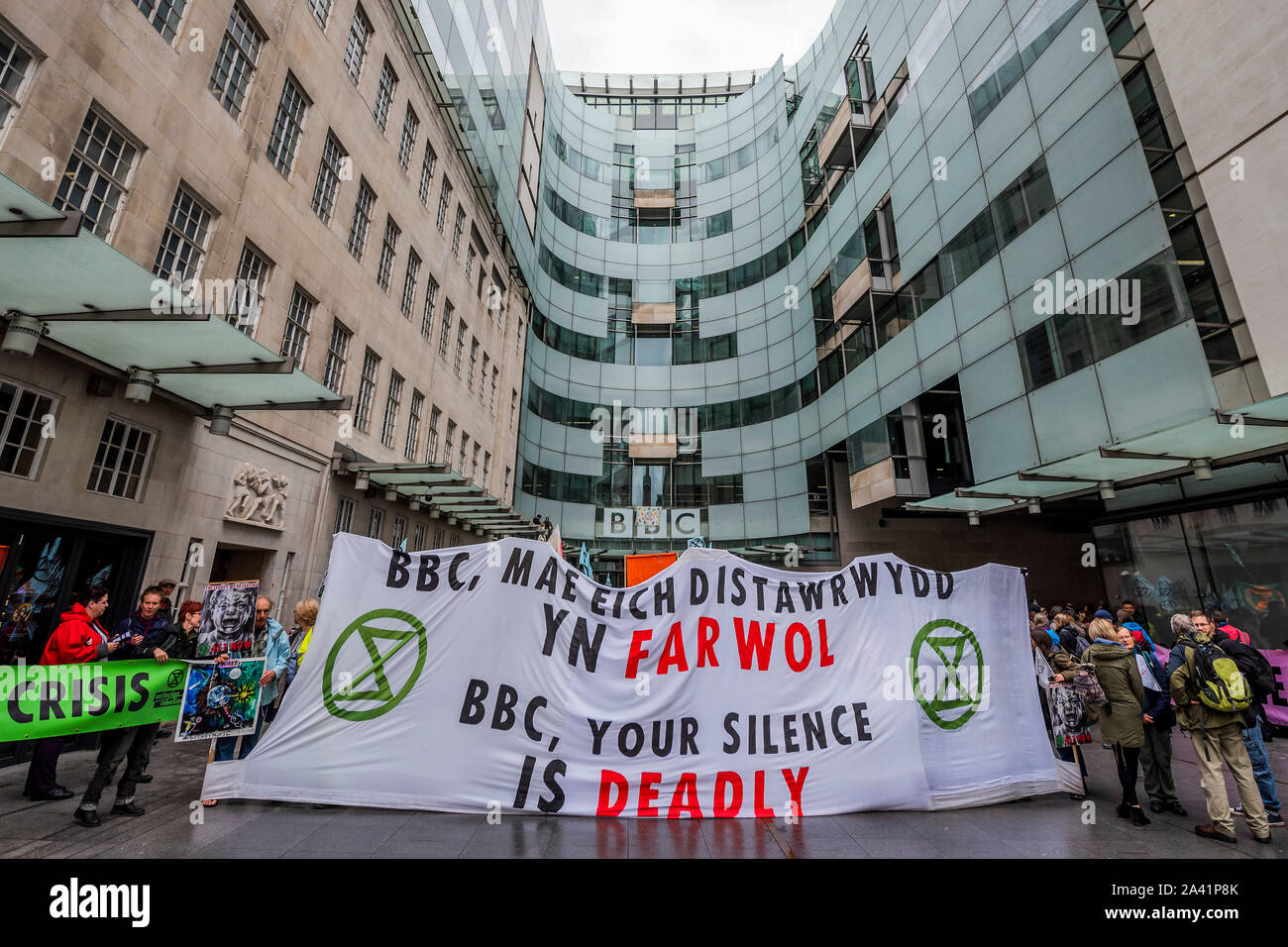London, UK. 11th Oct, 2019. XR Wales blockade the BBC Broadcasting House in Portland Place because they believe they have been slow to speak up on climate change - The fifth day of the Extinction Rebellion October action which has blocked roads in central London. They are again highlighting the climate emergency, with time running out to save the planet from a climate disaster. This is part of the ongoing ER and other protests to demand action by the UK Government on the 'climate crisis'. The action is part of an international co-ordinated protest. Credit: Guy Bell/Alamy Live News Stock Photo