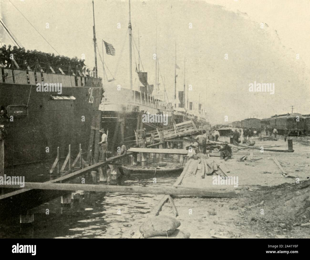 """'At the Dock, June 10th', Spanish-American War, 1898, (1899). Ships in the harbour at Port Tampa, Florida, USA. They were taking American troops to Cuba. From """"The Little I saw of Cuba"""" by Burr McIntosh, with photographs by the author. (In 1898, American actor and journalist William Burr McIntosh went to Cuba to cover the Spanish-American War for """"Leslie's Weekly"""" as a reporter and photographer). [F. Tennyson Neely, London & New York, 1899] Stock Photo"""