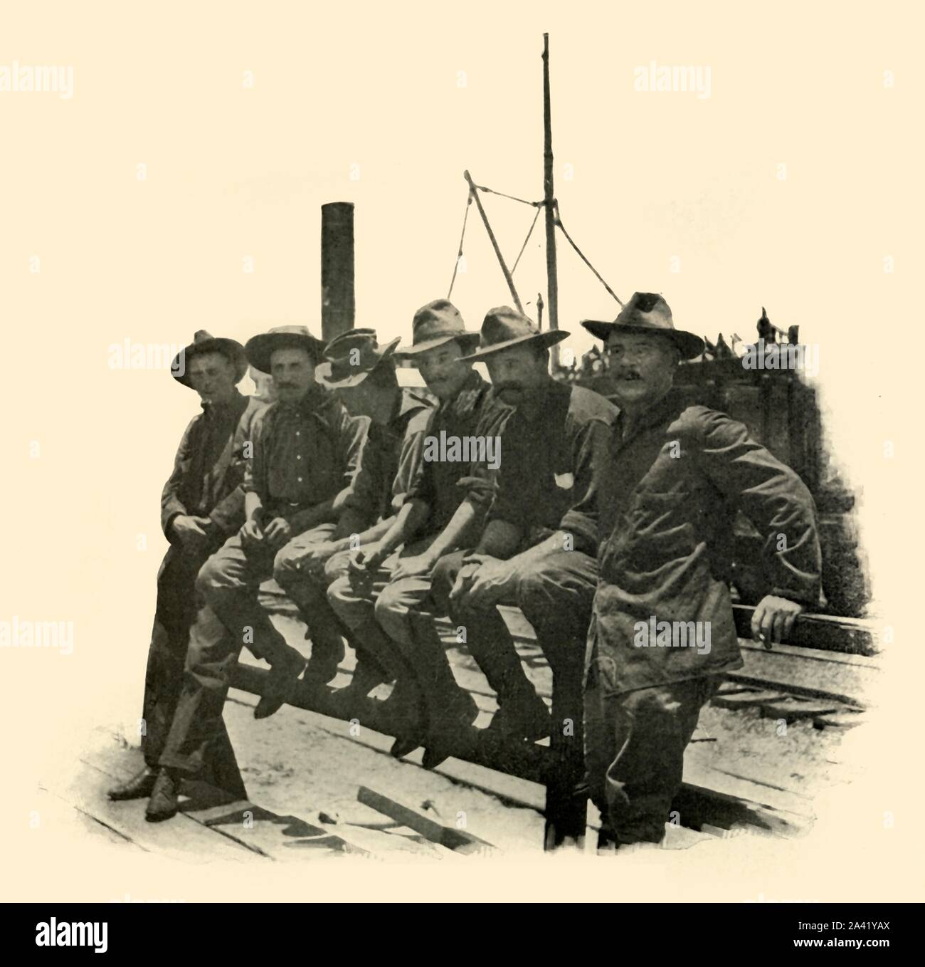 """'Rough Riders', Spanish-American War, 12 June 1898, (1899). Soldiers of the 1st United States Volunteer Cavalry, known as the Rough Riders, preparing to leave for Cuba from Port Tampa, Florida, USA. From """"The Little I saw of Cuba"""" by Burr McIntosh, with photographs by the author. (In 1898, American actor and journalist William Burr McIntosh went to Cuba to cover the Spanish-American War for """"Leslie's Weekly"""" as a reporter and photographer). [F. Tennyson Neely, London & New York, 1899] Stock Photo"""