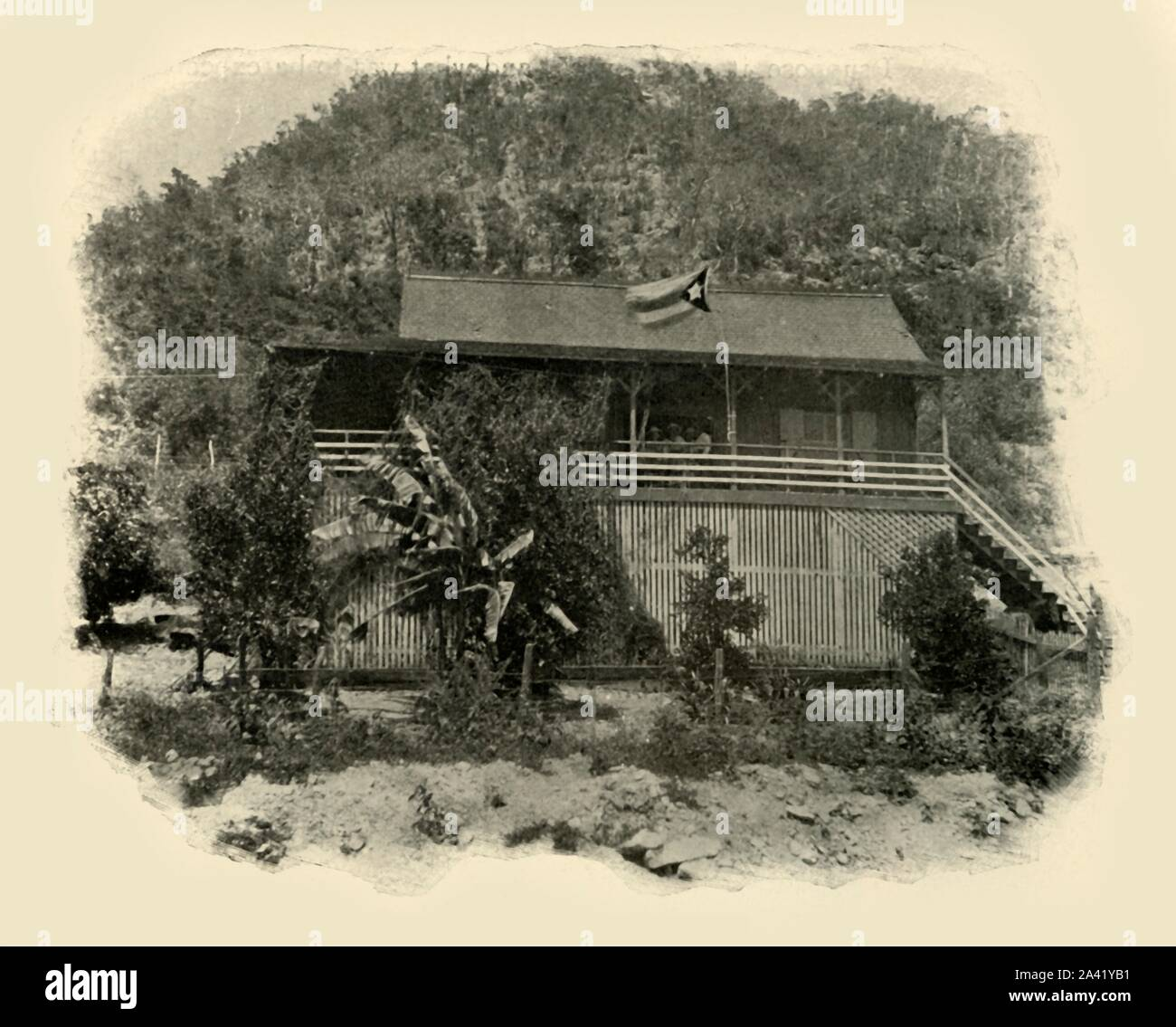 """'Cuban Headquarters at Daiquiri', Spanish-American War, June 1898, (1899). On 22 June 1898, American and Cuban troops attacked Spanish troops stationed at the small village of Daiquirí near Santiago de Cuba. From """"The Little I saw of Cuba"""" by Burr McIntosh, with photographs by the author. (In 1898, American actor and journalist William Burr McIntosh went to Cuba to cover the Spanish-American War for """"Leslie's Weekly"""" as a reporter and photographer). [F. Tennyson Neely, London & New York, 1899] Stock Photo"""