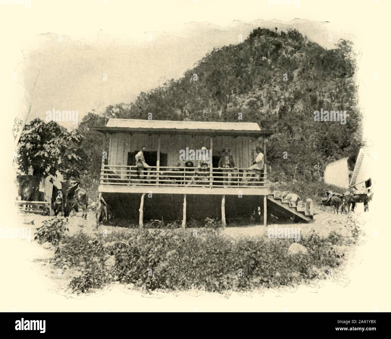 """Journal"" Headquarters, Daiquiri', Spanish-American War, June 1898, (1899). On 22 June 1898, American troops landed at the small village of Daiquirí near Santiago de Cuba and attacked the Spanish troops stationed there. This building may have been used by the journalists covering the war. From ""The Little I saw of Cuba"" by Burr McIntosh, with photographs by the author. (In 1898, American actor and journalist William Burr McIntosh went to Cuba to cover the Spanish-American War for ""Leslie's Weekly"" as a reporter and photographer). [F. Tennyson Neely, London &a Stock Photo"
