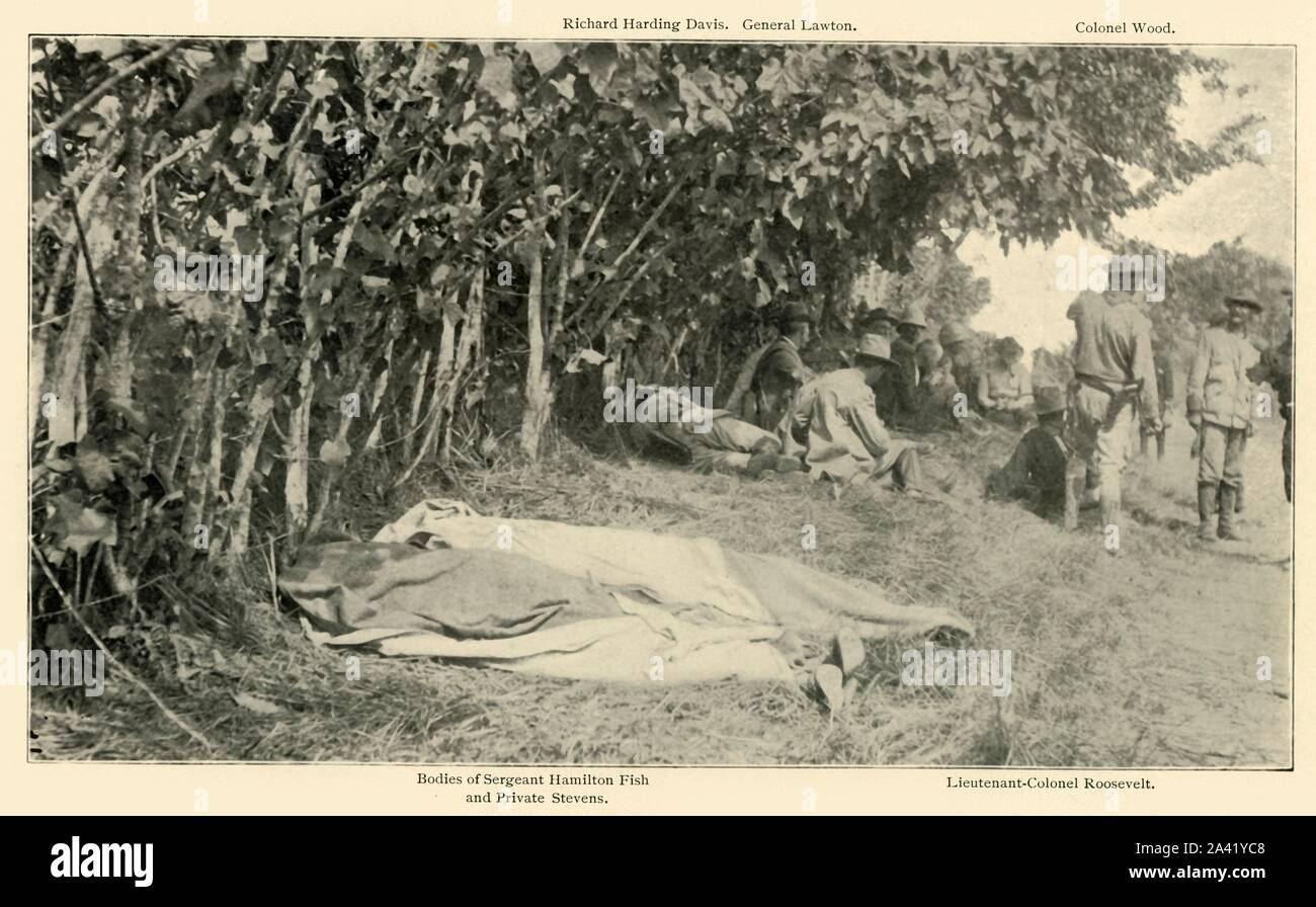 """'Scene after """"Rough Riders"""" Battle, June 24th', Spanish-American War, Cuba, 1898, (1899). In the foreground are the bodies of Sergeant Hamilton Fish and Private Stevens of the 1st United States Volunteer Cavalry, killed in the Battle of Las Guasimas. Behind them is a meeting of US officers and war correspondents: journalist Richard Harding Davis, General Henry Ware Lawton, General Leonard Wood, and (future president) Lieutenant Colonel Theodore Roosevelt. From """"The Little I saw of Cuba"""" by Burr McIntosh, with photographs by the author. (In 1898, American actor and journalis Stock Photo"""