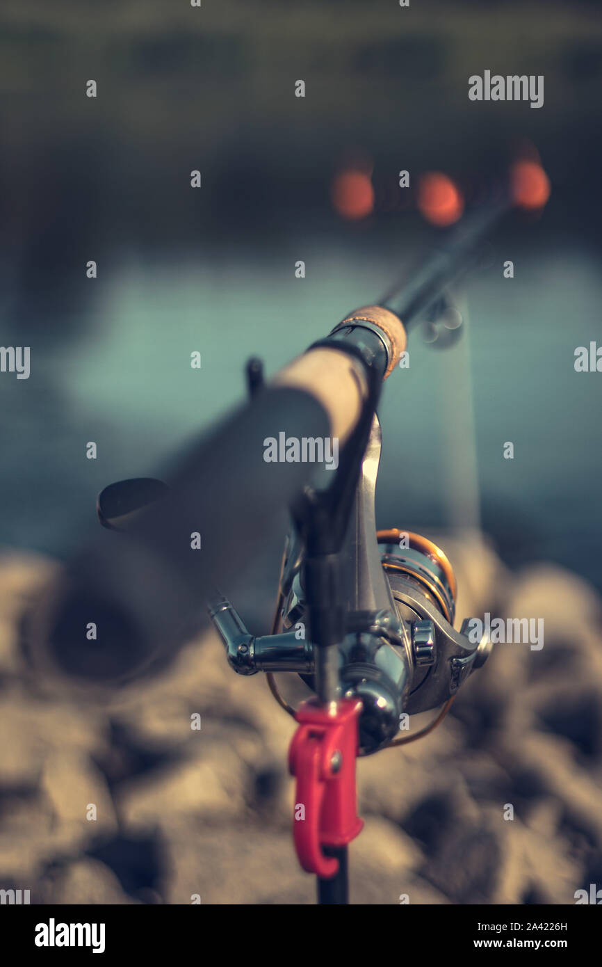 Fishing rod with a blurred background on a beautiful sunny day Stock Photo