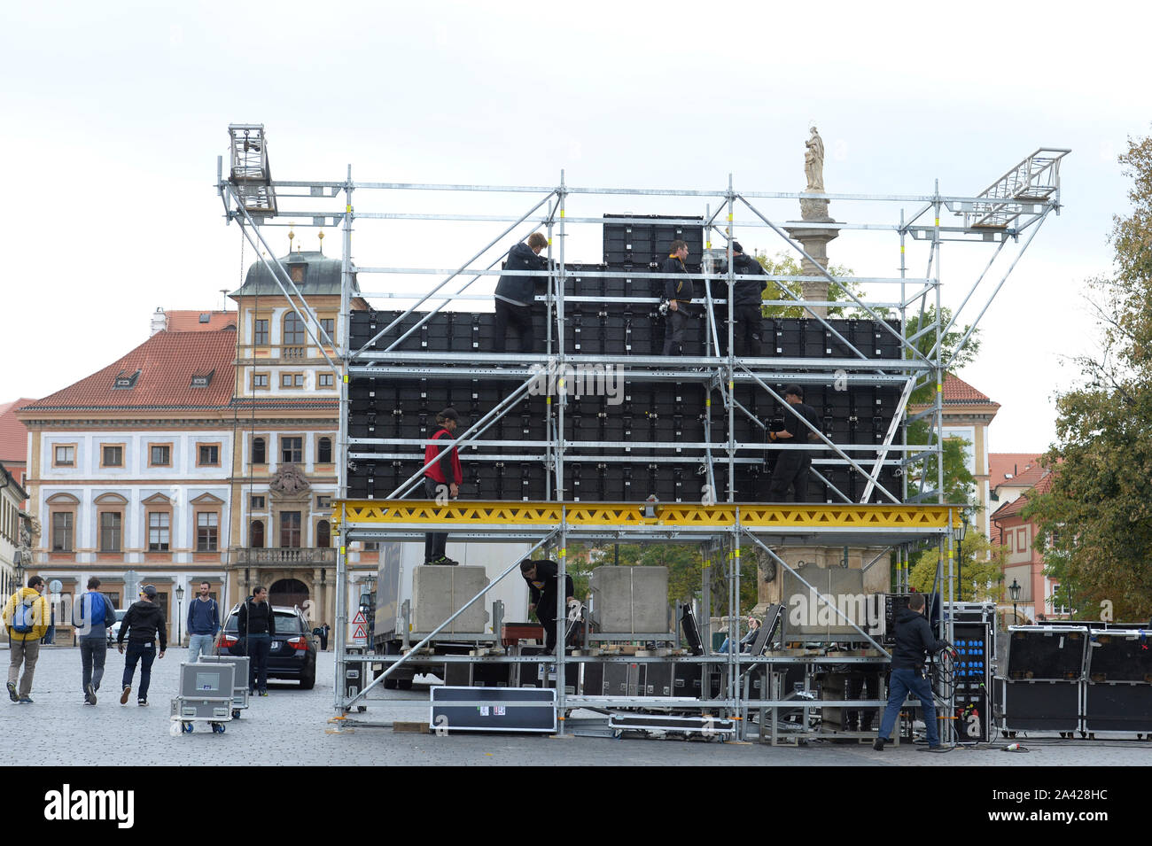 The instalation of the large-scale screen on Hradcany square outside the Prague Castle, Prague, Czech Republic, October 11, 2019. On Saturday, October 12, a mourning ceremony will take place in St Vitus Cathedral at the Prague Castle, the seat of Czech kings and presidents, at 11:00. The heritage site will be partially closed to the public until 14:00 over the event that will be for invited guests only. The public can watch it on large-scale screens. Czech pop singer Karel Gott died at 80 on October 1, 2019, before midnight at home in his family circle. Gott was at the top of music for some 60 Stock Photo
