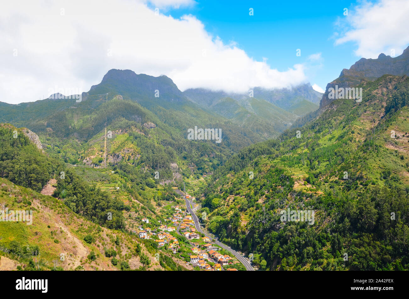 Stunning view of picturesque village Serra de Aqua in Madeira Island, Portugal. Small city in a valley surrounded by green mountains. Portuguese landscape. Amazing travel destinations. Stock Photo