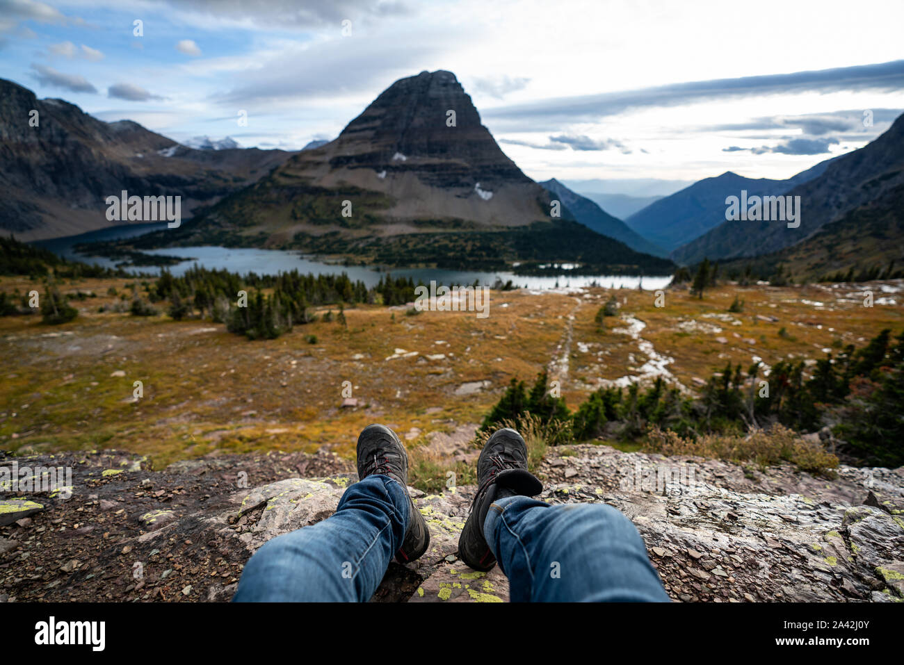 Photo from the Point of view of the photographer sitting down at the viewpoint at Hidden Lake, Montana. Stock Photo