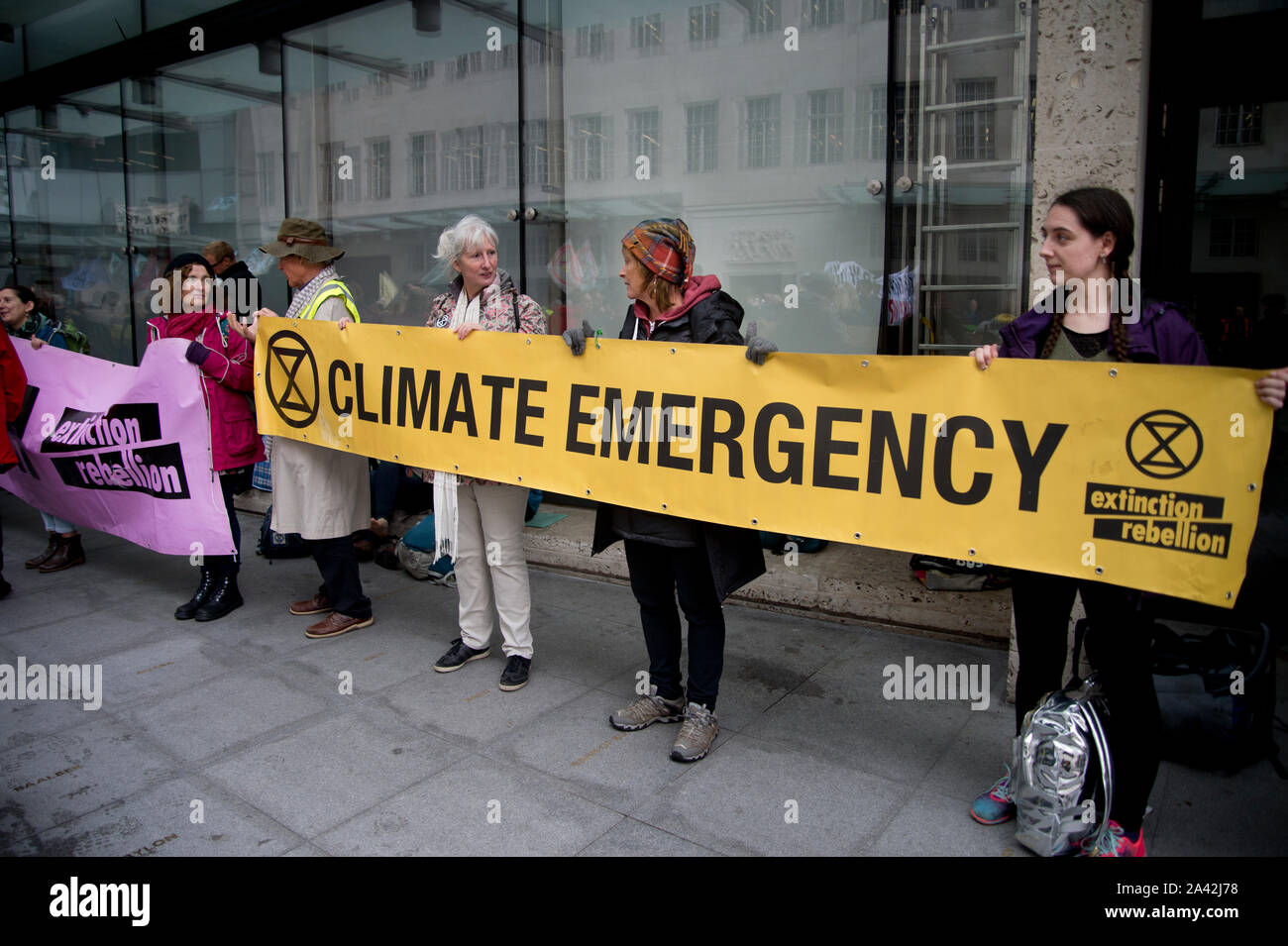 Extinction Rebellion,  London, October 11th 2019. Occupying the BBC, Oxford Circus. Protesters with a banner saying 'Climate Emergency'. Stock Photo