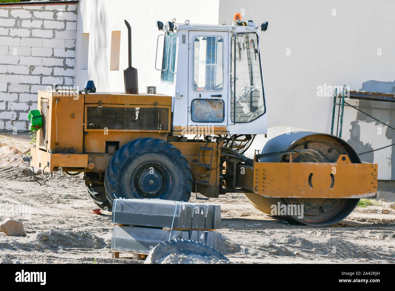 Heavy vibratory roller. road stacker. Orange color. Stock Photo