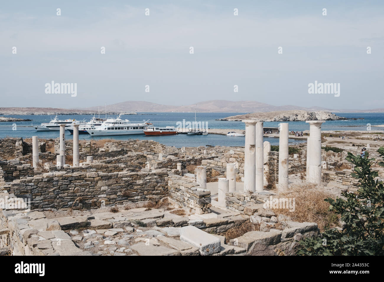 Delos, Greece - September 20, 2019: Ruins on the Island of Delos, archaeological site near Mykonos in the Aegean Sea Cyclades archipelago, tour boats Stock Photo