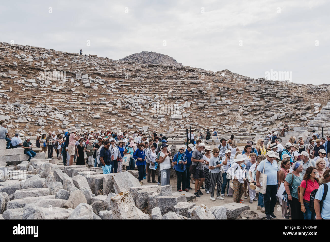 Delos, Greece - September 20, 2019: Large number of tourists leaving after performance at the ancient theatre on the Greek island of Delos, an archaeo Stock Photo