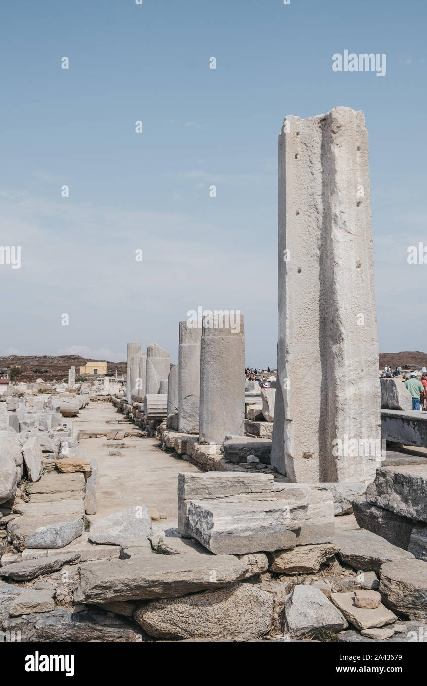 Delos, Greece - September 20, 2019: Columns and ruins on the Sacred Way on the island of Delos, Greece, an archaeological site near Mykonos in the Aeg Stock Photo