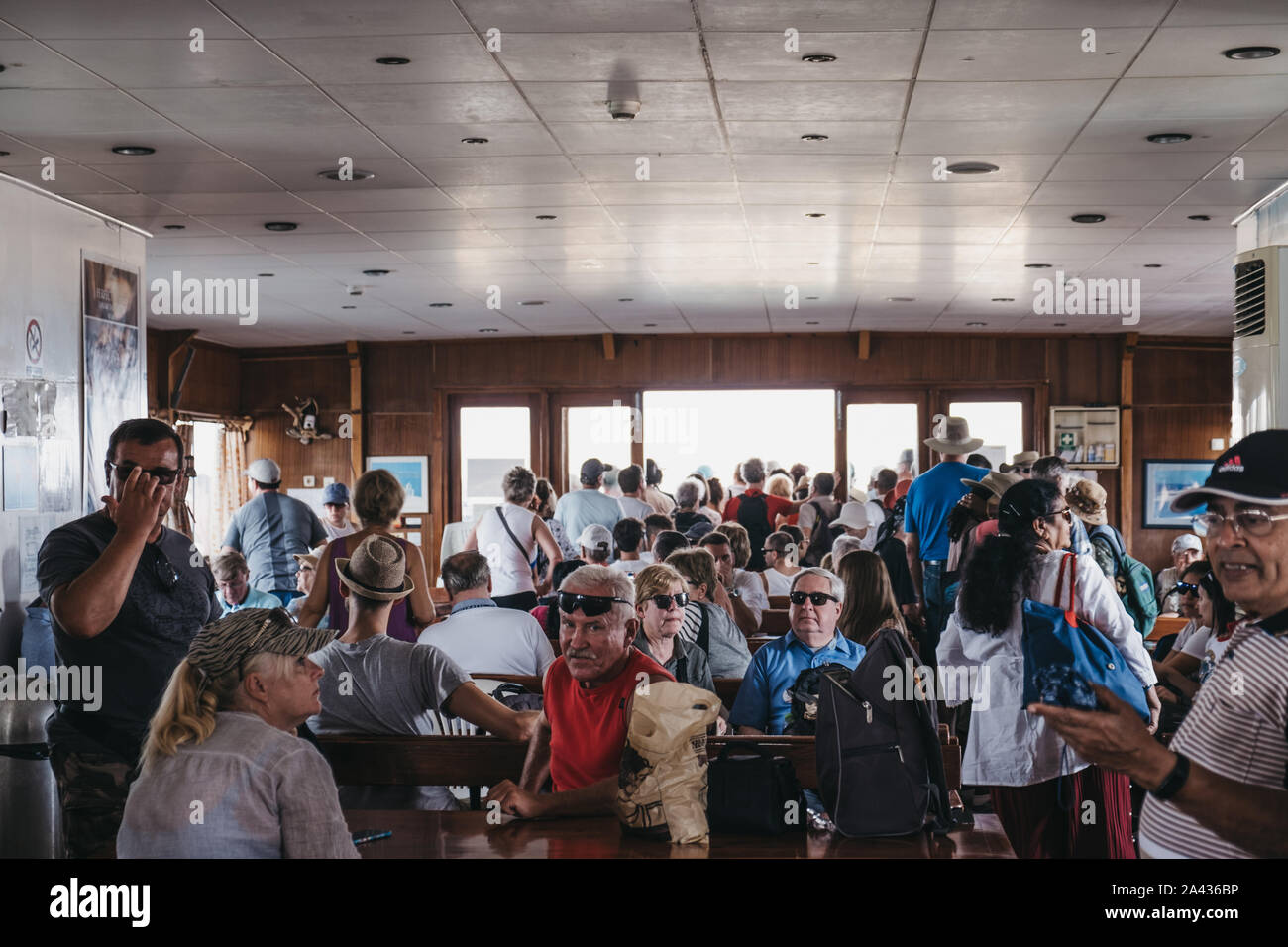 Delos, Greece- September 20, 2019: People waiting to disembark Delos Tours boat that has just arrived to to the island of Delos, a famous archaeologic Stock Photo