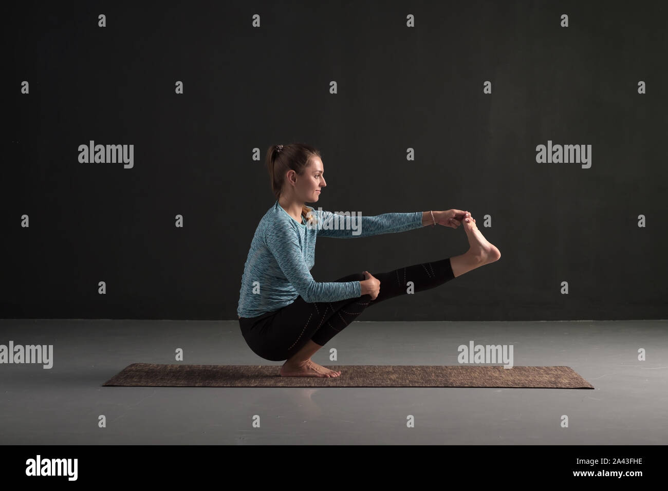 Young beautiful woman in yoga pose balancing on one leg Stock ...