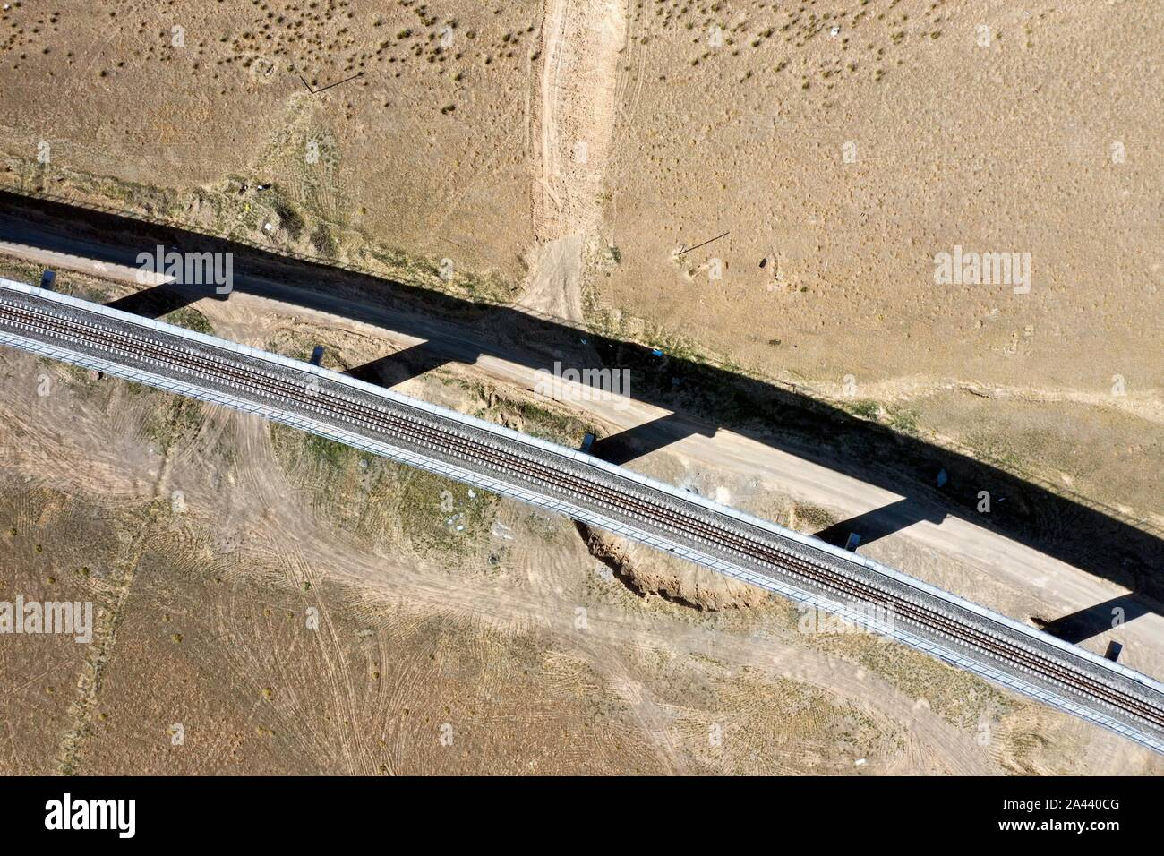 A train runs on the section between Kuytun and Tacheng Prefecture of the Karamay-Tacheng railway line in northwest China's Xinjiang Uygur Autonomous R Stock Photo