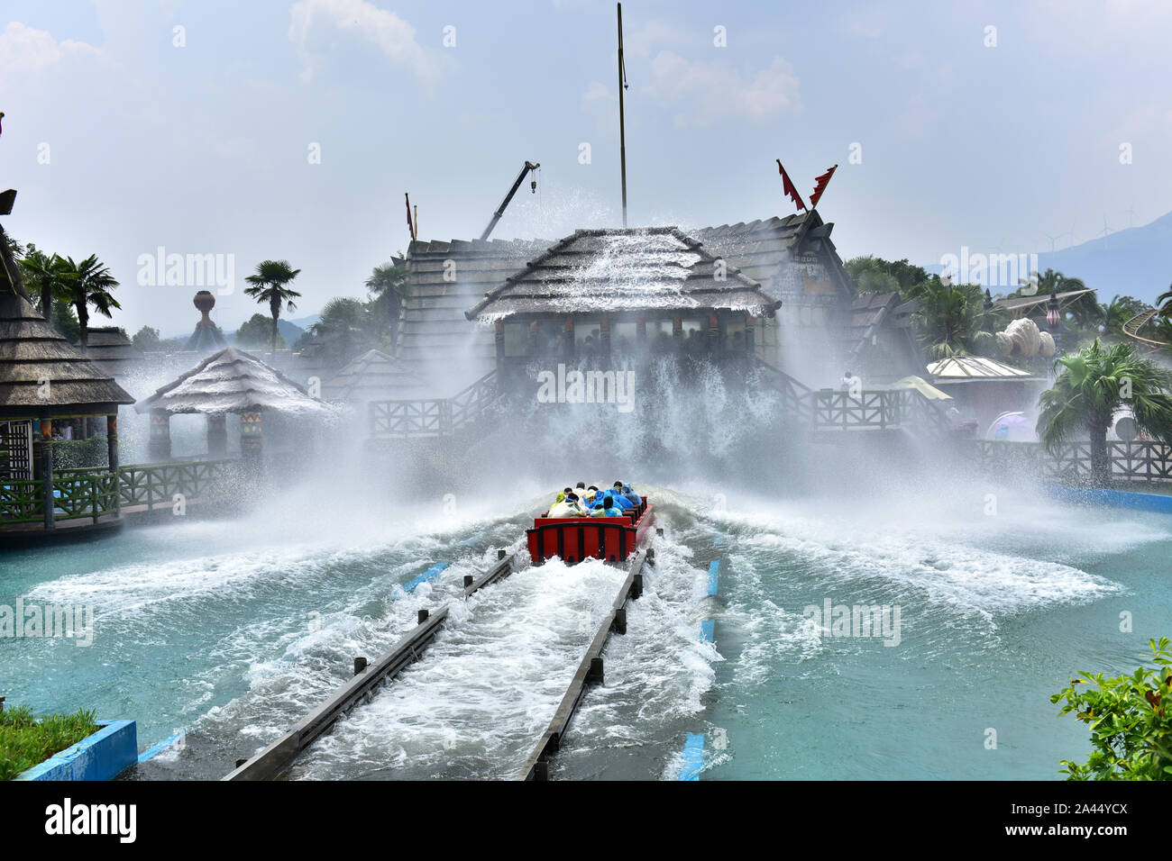 A rollar coaster with passengers is ''surfing'' in Guilin Merryland Theme Part in Guilin city, south China's Guangxi Zhuang Autonomous Region, 25 Augu Stock Photo