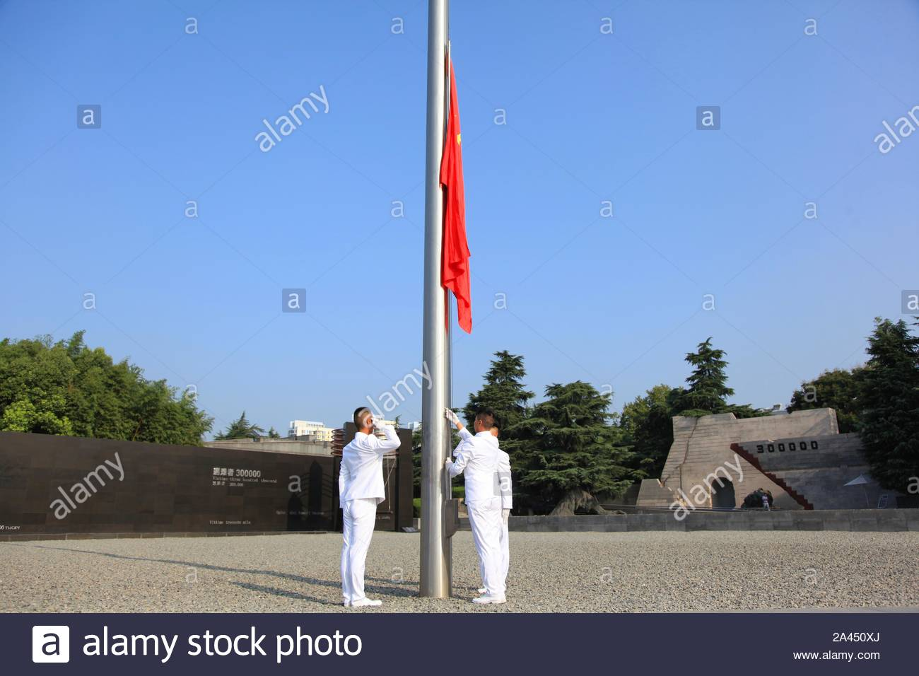 Representatives march during a flag-raising ceremony to commemorate the 74th anniversary of Japan's unconditional surrender in World War II at the Mem Stock Photo
