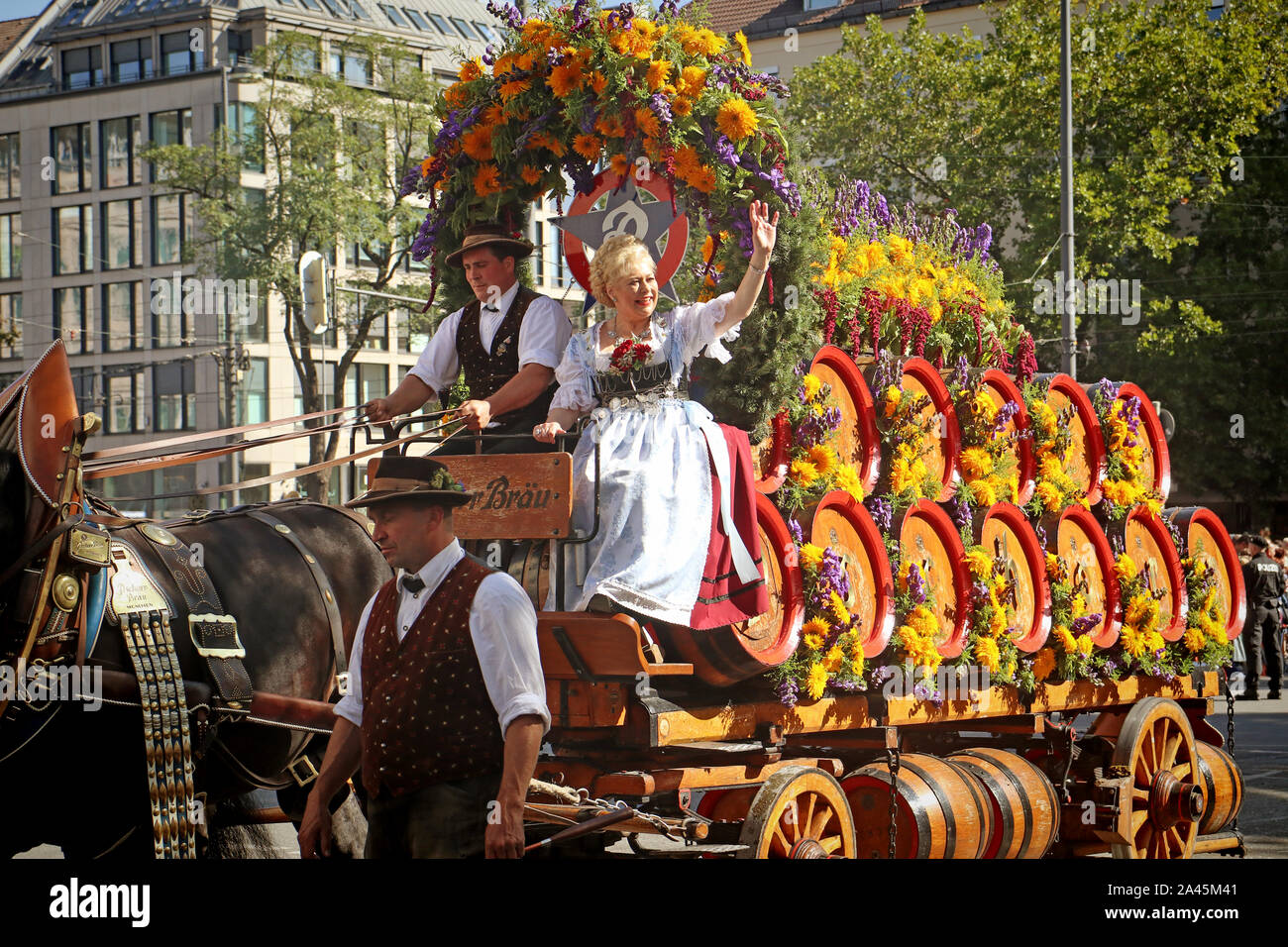 MUNICH, GERMANY - SEPTEMBER 22, 2019 Grand entry of the Oktoberfest landlords and breweries, festive parade of magnificent decorated carriages and ban Stock Photo