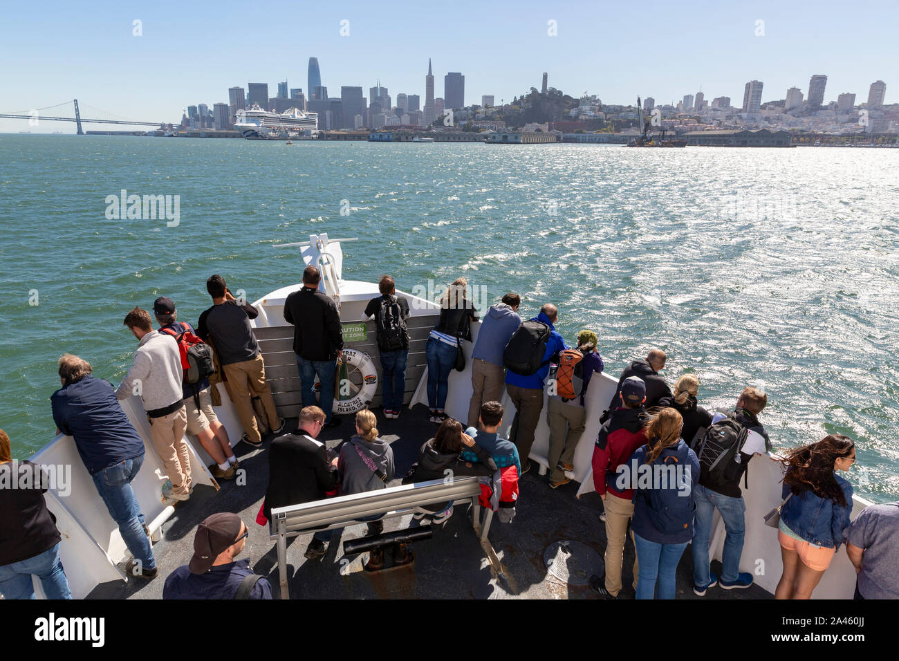 SAN FRANCISCO, USA - OCTOBER  2, 2019 : People on the Alcatraz tour ship as it sails across the  San Francisco bay with views of the city skyline. Stock Photo