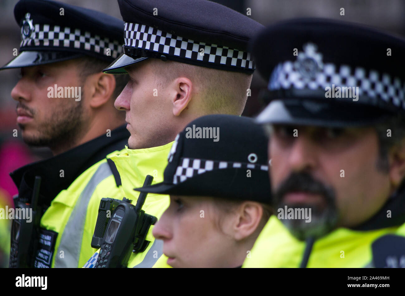 London, UK. 11 October 2019. Metropolitan Police officers keep climate change protestors off roads around Trafalgar Square, London. Extinction Rebellion, were still occupying Trafalgar Square despite many of their campsites around Westminster being removed by police. The group have been involved in non-violent civil disobedience. Over 1,000 arrests were made during the first week of protests. 500 officers were drafted in from around England and Wales to help support the Metropolitan police. Stuart Walden / Alamy Stock Photo