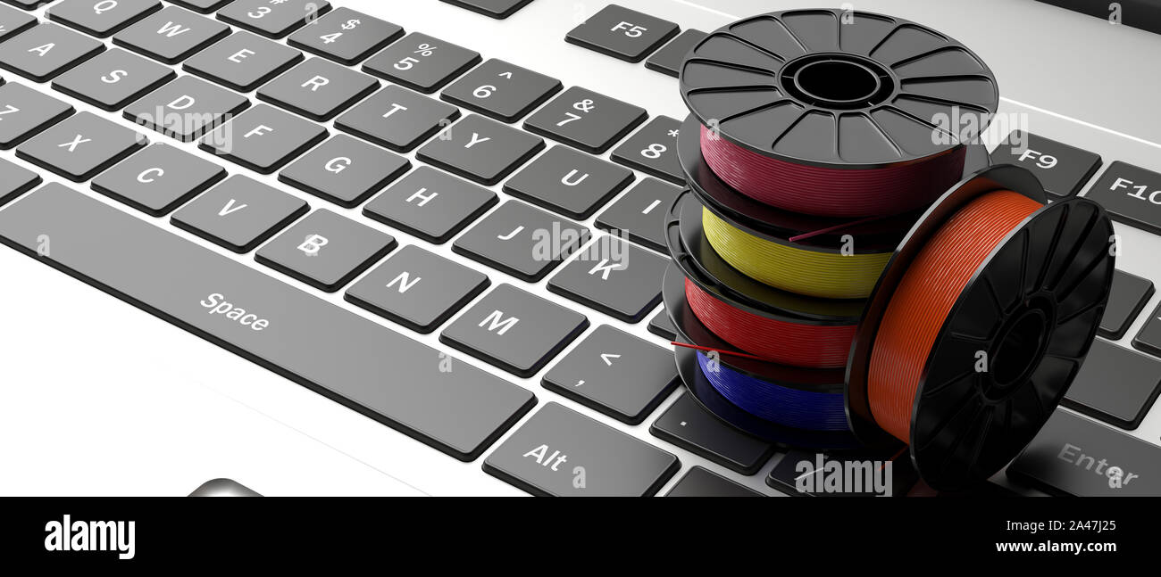3D printer computer software. Reels of colorful plastic filaments for 3D printing on a laptop keyboard, banner. 3d illustration Stock Photo
