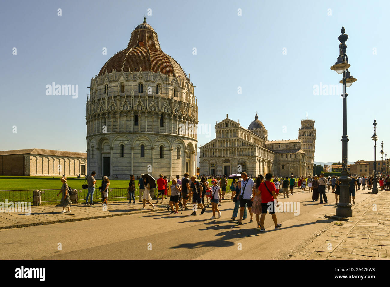 Scenic view of the famous Piazza dei Miracoli square in Pisa with the Baptistery of St John, the Cathedral and the Leaning Tower, Tuscany, Italy Stock Photo